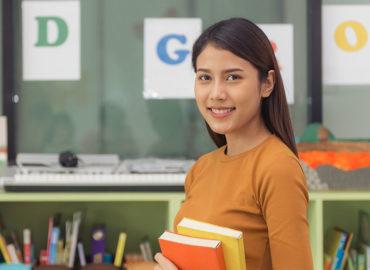 girl smiling holding books