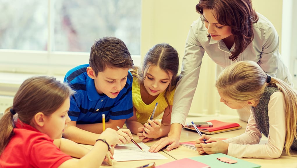 students working with a teacher