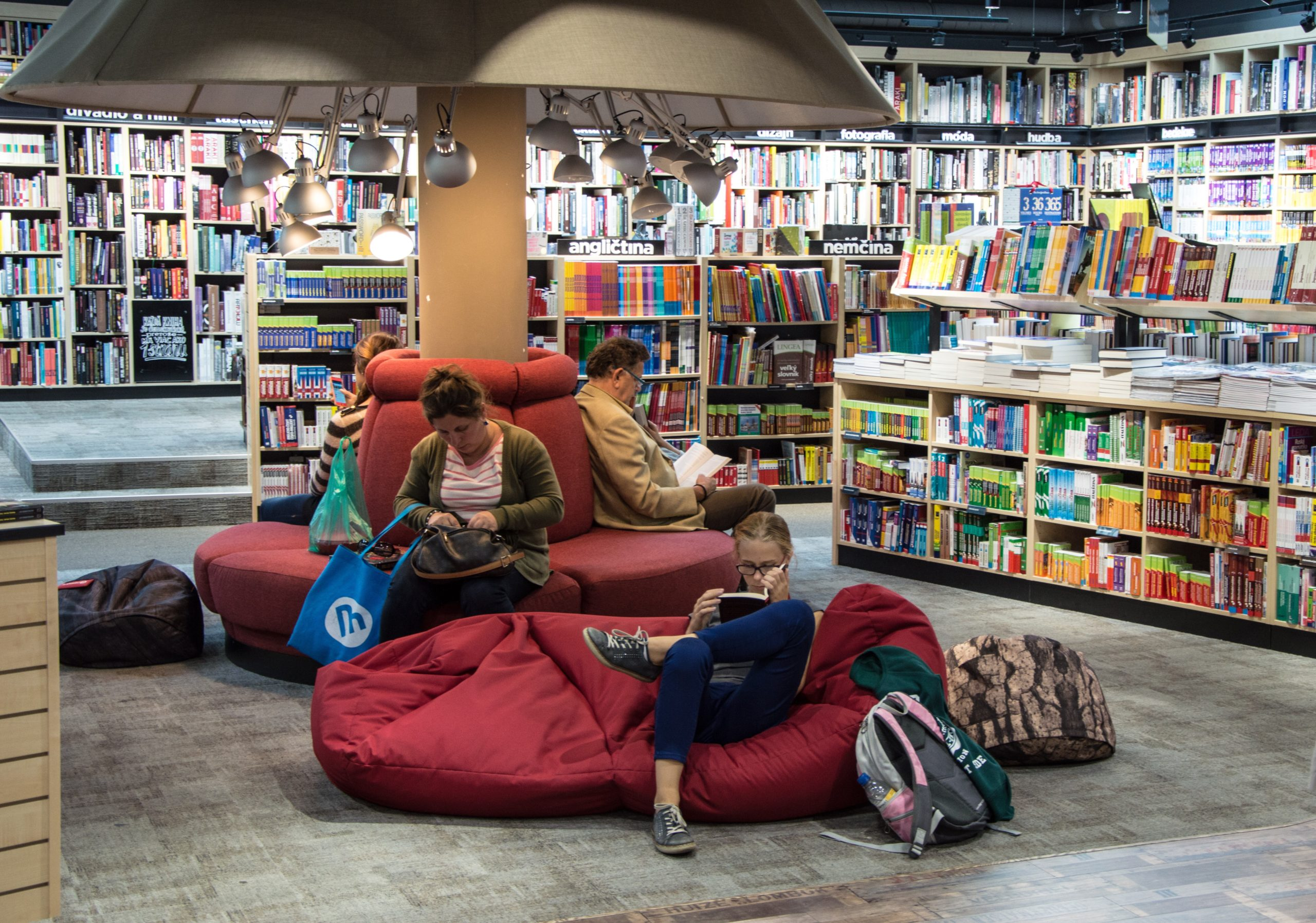 kids all in a library on bean bags