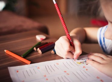 child writing on test paper