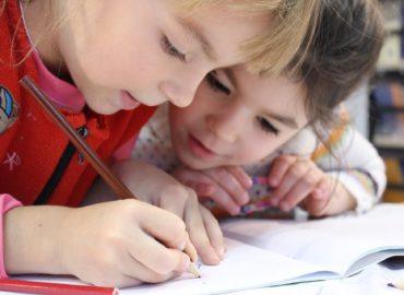 children writing on test paper