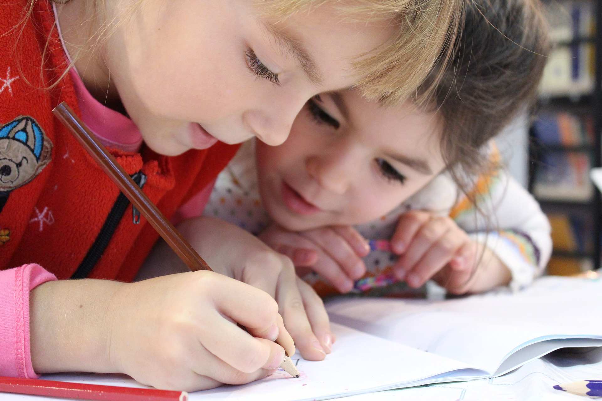 children writing on test paper