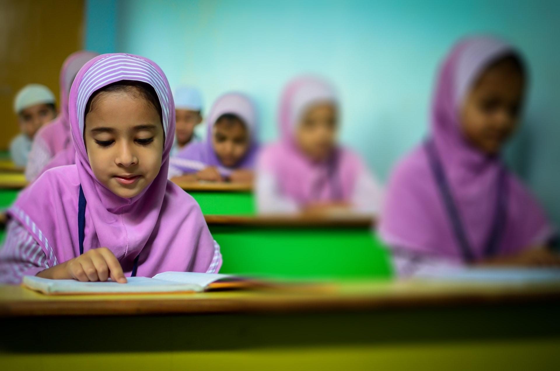 children reading in uniform