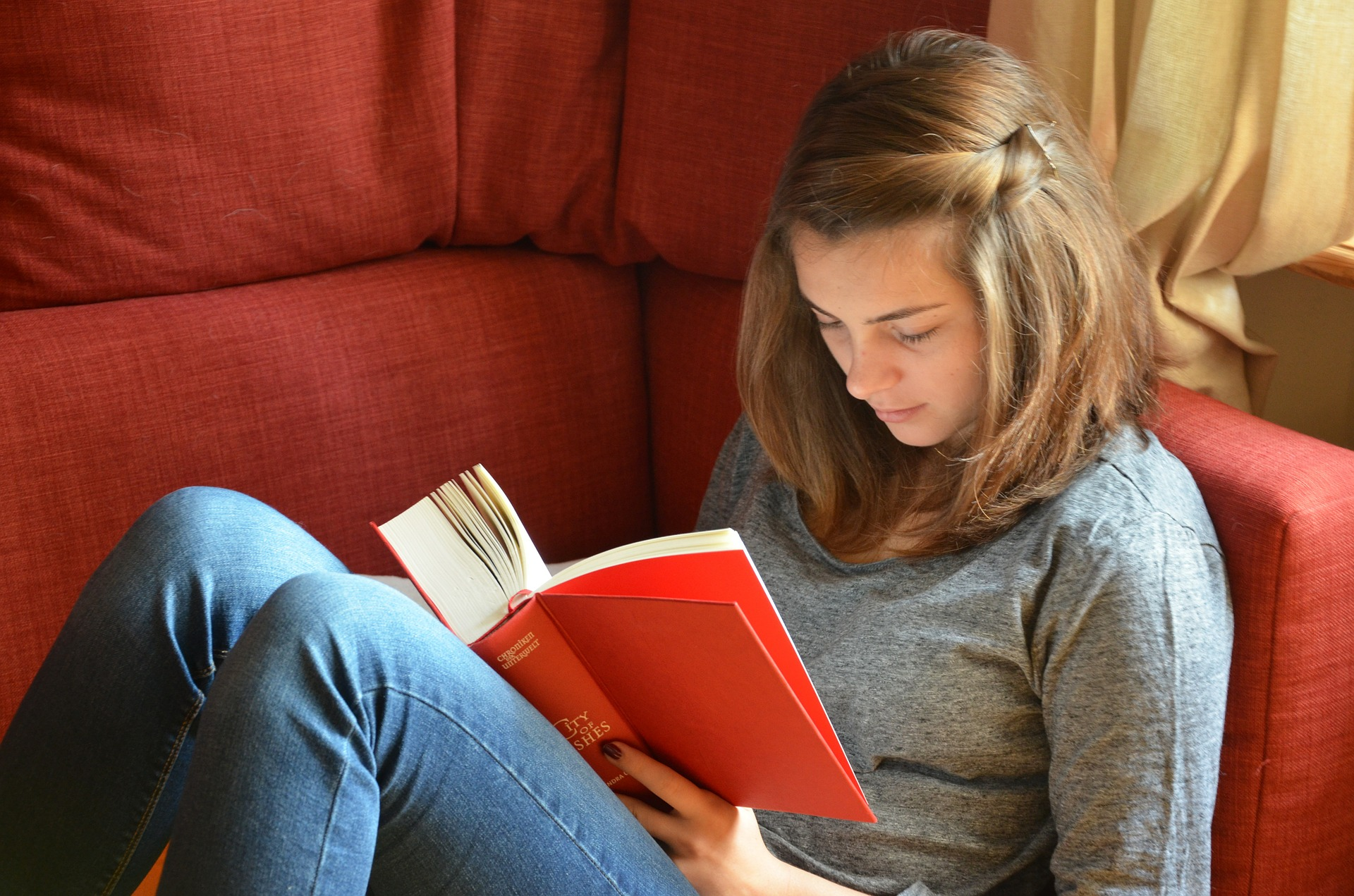 student reading book and thinking