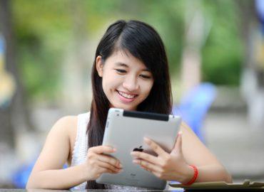 girl looking at ipad